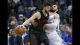 Portland Trail Blazers center Jusuf Nurkic, left, drives around Oklahoma City Thunder center Steven Adams, right, in the first half of an NBA basketball game in Oklahoma City, Monday, Feb. 11, 2019. (AP Photo/Sue Ogrocki)