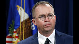 FILE- In this July 11, 2018, file photo Mick Mulvaney, acting director of the Consumer Financial Protection Bureau (CFPB), and Director of the Office of Management, listens during a news conference at the Department of Justice in Washington. White House Acting Chief of Staff Mick Mulvaney isn't setting any lofty goals for this weekend's meeting with a bipartisan mix of legislators at Camp David, but he is trying to build relationships across the aisle. (AP Photo/Jacquelyn Martin, File)