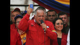 Diosdado Cabello, president of Constitutional Assembly, holds up a miniature copy of the Venezuelan Constitution, during a rally in Urena, Venezuela, Monday, Feb. 11, 2019. Nearly three weeks after the Trump administration backed an all-out effort to overthrow Maduro, the embattled leader's hold on power appears shaken, but he's far from losing grip. The world watches now whether Maduro's government will let humanitarian aid from the United States cross its borders. (AP Photo/Fernando Llano)