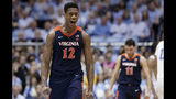 Virginia's De'Andre Hunter (12) reacts following a win over North Carolina following an NCAA college basketball game in Chapel Hill, N.C., Monday, Feb. 11, 2019. (AP Photo/Gerry Broome)