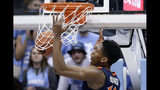 Virginia's De'Andre Hunter dunks against North Carolina during the first half of an NCAA college basketball game in Chapel Hill, N.C., Monday, Feb. 11, 2019. (AP Photo/Gerry Broome)