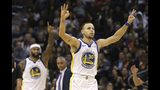 Golden State Warriors guard Stephen Curry (30) celebrates his 3-pointer against the Phoenix Suns along with Warriors center DeMarcus Cousins (0) during the second half of an NBA basketball game Friday, Feb. 8, 2019, in Phoenix. The Warriors defeated the Suns 117-107. (AP Photo/Ross D. Franklin)