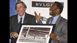 FILE - In this Thursday March 4, 2004 file photo Brazilian soccer legend Pele, right, presents former England goalkeeper Gordon Banks with a photograph showing Banks saving a header from Pele in the 1970 World Cup, at a press conference in London, to mark FIFA's 100 year anniversary. English soccer club Stoke said Tuesday Feb. 12, 2019 that World Cup-winning England goalkeeper Gordon Banks has died at 81. (AP Photo/Max Nash, File)
