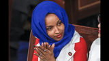 """FILE - In this Feb. 5, 2019, file photo, Rep. Ilhan Omar, D-Minn., listens to President Donald Trump's State of the Union speech, at the Capitol in Washington. Omar """"unequivocally"""" apologized Monday, Feb. 11, 2019, for tweets suggesting that members of Congress support Israel because they are being paid to do so, which drew bipartisan criticism and a rebuke from House Speaker Nancy Pelosi. (AP Photo/J. Scott Applewhite, File)"""