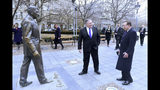 US Secretary of State, Mike Pompeo, center, is pictured next to a scuplture of former US President Ronald Reagan at the Liberty square (Szabadsag) in Budapest, Hungary, Feb. 11, 2019. (Attila Kisbendek/Pool Photo via AP)