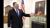 US Secretary of State, Mike Pompeo, gestures in the memorial room of late Hungarian Cardinal Jozsef Mindszenthy at the US embassy in Budapest, Hungary, Feb. 11, 2019. Mindszenthy lived in this room at the US embassy building after the 1956 Hungarian uprising, between November 4, 1956 and September 28, 1971. (Attila Kisbendek/Pool Photo via AP)