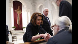 House Speaker Nancy Pelosi and Rep. Steny Hoyer, D-Md., greet family members before a funeral service for former Rep. John Dingell, Thursday, Feb. 14, 2019 at Holy Trinity Catholic Church in Washington. Dingell, who represented southeast Michigan for 59 years in the House of Representatives, died last week at age 92. (AP Photo/Pablo Martinez Monsivais, Pool)