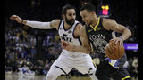 Golden State Warriors' Stephen Curry, right, drives as Utah Jazz guard Ricky Rubio defends during the second half of an NBA basketball game Tuesday, Feb. 12, 2019, in Oakland, Calif. (AP Photo/Ben Margot)
