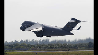 US military planes head for Venezuela with aid