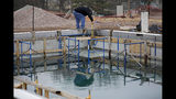 In this Tuesday, Feb. 5, 2019 photo, worker Danny Marr takes a measurement of the pool that is under construction at Lacy Park in Tulsa, Okla. The pool won't be open as planned due to being built at the wrong elevation. (Mike Simons/Tulsa World via AP)