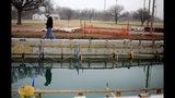 In this Tuesday, Feb. 5, 2019 photo, worker Danny Marr looks over the pool that is under construction at Lacy Park in Tulsa, Okla. The pool won't be open as planned due to being built at the wrong elevation. (Mike Simons/Tulsa World via AP)