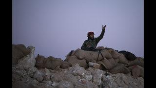 Civilians, including many children, leave IS-held enclave