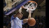 North Carolina's Cameron Johnson (13) dunks against Duke during the first half of an NCAA college basketball game in Durham, N.C., Wednesday, Feb. 20, 2019. (AP Photo/Gerry Broome)