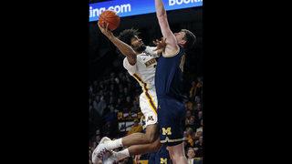 Poole has 22 points, No. 7 Michigan beats Minnesota 69-60