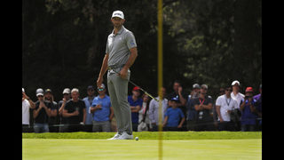 Johnson builds 2-shot lead in Mexico as Woods rallies