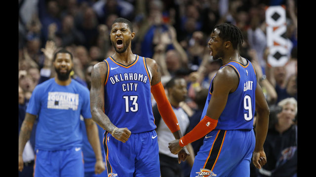 24de7a86073 Oklahoma City Thunder forwards Paul George (13) and Jerami Grant (9)  celebrate after George hit a shot with less than a second left in the  second overtime ...