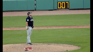 Slowly, baseball rolls out pitch clock in spring training