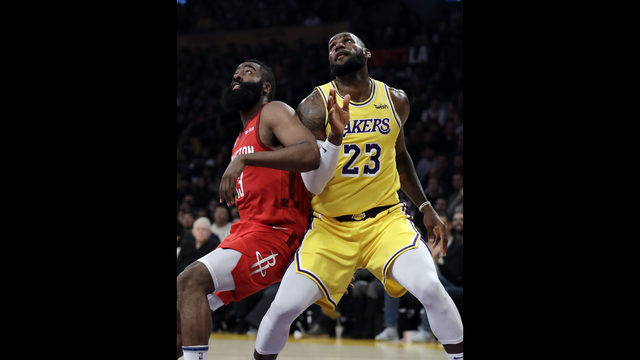 821890519707 Los Angeles Lakers  LeBron James (23) vies for position under the basket  next to Houston Rockets  James Harden during the first half of an NBA  basketball ...