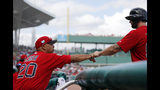 Boston Red Sox manager Alex Cora (20) greets Sam Travis after he scored on a single off the bat of Juan Centeno in the eighth inning of their spring training baseball game against the Yankees in Fort Myers, Fla., Saturday, Feb. 23, 2019. (AP Photo/Gerald Herbert)