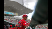 Boston Red Sox manager Alex Cora (20) smiles in the dugout in the seventh inning of their spring training baseball game against the New York Yankees in Fort Myers, Fla., Saturday, Feb. 23, 2019. The Red Sox won 8-5. (AP Photo/Gerald Herbert)