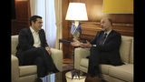 Greek Prime Minister Alexis Tsipras, left, meets with European Commissioner for Economic and Financial Affairs Pierre Moscovici in Athens, on Thursday, Feb. 28, 2019 .(AP Photo/Petros Giannakouris)