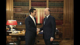 Greek Prime Minister Alexis Tsipras, left, meets with European Commissioner for Economic and Financial Affairs Pierre Moscovici in Athens, on Thursday, Feb. 28, 2019. (AP Photo/Petros Giannakouris)