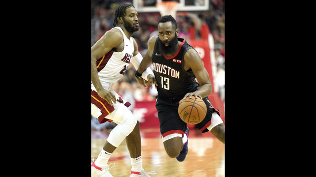 Houston Rockets  James Harden (13) drives toward the basket as Miami Heat s  Justise Winslow defends during the second half of an NBA basketball game ... ba92b9bb8