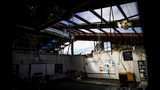 Daylight pours in through the damaged roof of a classroom at Springfield Elementary School which has remained closed since Hurricane Michael hit Panama City, Fla, Thursday, Jan. 24, 2019. Bay District Schools Superintendent Bill Husfelt said the county's student population has decreased by 14 percent since the storm, with some individual schools down by more than 40 percent. (AP Photo/David Goldman)
