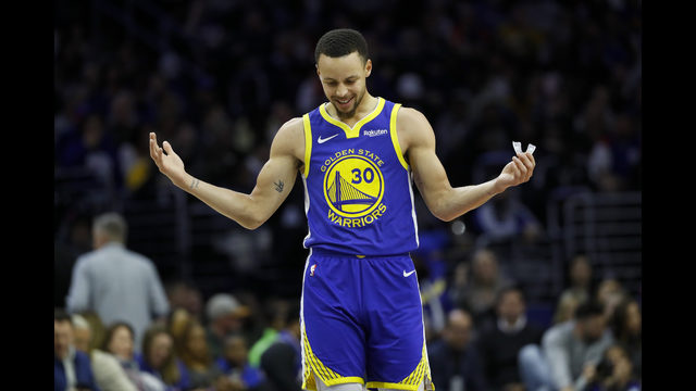 ef31b0551bd Golden State Warriors' Stephen Curry reacts after a foul was called against  him during the first half of an NBA basketball game against the  Philadelphia ...