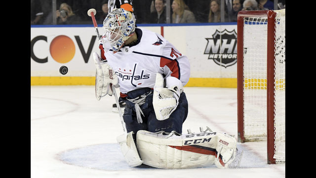 279d391080b Washington Capitals goaltender Braden Holtby (70) stops the puck during the  second period of an NHL hockey game against the New York Rangers