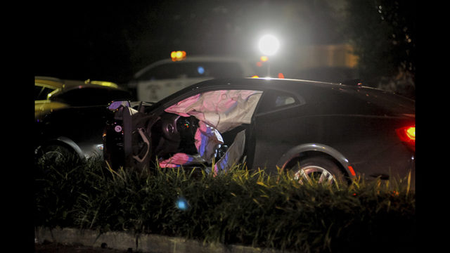 New Orleans Police Department officers process a damaged vehicle after responding to a fatal hit and run accident along Esplanade Avenue in Bayou St. John ...