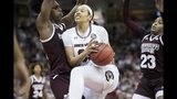 South Carolina forward Alexis Jennings drives to the hoop against Mississippi State center Teaira McCowan, left, and Bre'Amber Scott (23) during the second half of an NCAA college basketball game Sunday, March 3, 2019, in Columbia, S.C. Mississippi State defeated South Carolina 68-64. (AP Photo/Sean Rayford)