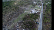 A truck, lower right, lies on its side in a neighborhood devastated by a tornado that saw multiple members of a family killed in Beauregard, Ala., Tuesday, March 5, 2019. (AP Photo/David Goldman)