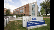 FILE - This Oct. 14, 2015 file photo shows the Food & Drug Administration campus in Silver Spring, Md. On Friday, March 8, 2019, the FDA approved Roche's Tecentriq, the first cancer immunotherapy for treating an aggressive type of breast cancer. (AP Photo/Andrew Harnik, File)