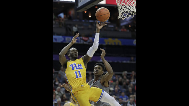 Pittsburgh s Sidy N Dir (11) shoots against Boston College s Jared Hamilton  during the first half of an NCAA college basketball game in the Atlantic  Coast ... 4ca640de00139