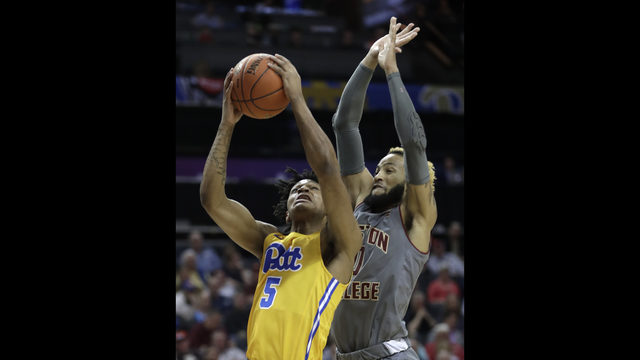 Pittsburgh s Au Diese Toney (5) shoots next to Boston College s Ky Bowman  during the first half of an NCAA college basketball game in the Atlantic  Coast ... 589ddf9e18c27
