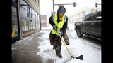 Ryan Bredensteiner of Top Flight Maintenance shovels Central Avenue during a blizzard on Wednesday, March 13, 2019, in Cheyenne. White-out conditions closed I-80, I-25, and U.S. 85, effectively closing off the state capital from Nebraska, Colorado and the rest of Wyoming. (Jacob Byk/The Wyoming Tribune Eagle via AP)