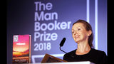 """FILE - In this Oct. 16, 2018 file photo, author Anna Burns smiles after being presented with the Man Booker Prize for Fiction 2018 for """"Milkman,"""" during the prize's 50th year at the Guildhall in London. Burns' """"Milkman"""" has been awarded the National Book Critics Circle prize for fiction.(AP Photo/Frank Augstein, File)"""