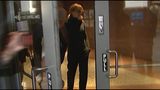 In this still image taken from video, actress Felicity Huffman walks towards the door in the lobby of a Los Angeles court after she is released on a $250,000 bond, Tuesday, March 12, 2019. Huffman is among 50 people charged in a scheme in which wealthy parents allegedly bribed college coaches and other insiders to get their children into some of the nation's most selective schools. (AP Photo/Rick Taber)