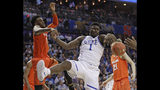 Duke's Zion Williamson, right, battles Syracuse's Oshae Brissett, left, for a rebound during the first half of an NCAA college basketball game in the Atlantic Coast Conference tournament in Charlotte, N.C., Thursday, March 14, 2019. (AP Photo/Nell Redmond)
