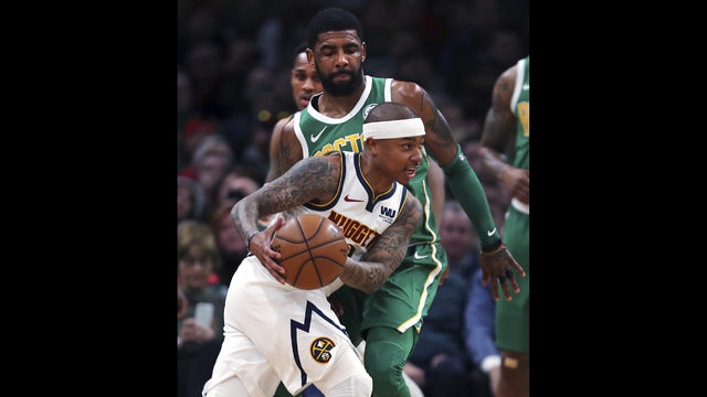 3b985bad2 Denver Nuggets guard Isaiah Thomas drives past Boston Celtics guard Kyrie  Irving