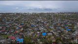 The poor neighbourhood of Nhamudima, which has been razed by the passing cyclone, in the coastal city of Beira, Mozambique, Sunday March 17, 2019. Families are returning to the vulnerable Nhamudima shanty town following cyclone high winds and rain. More than 1,000 people are feared dead in Mozambique four days after a cyclone slammed into the southern African country. (Josh Estey/CARE via AP)