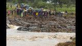 Schoolchildren are stranded across a collapsed bridge in Chimanimani, southeast of Harare, Zimbabwe, Monday, March 18, 2019. (AP Photo/Tsvangirayi Mukwazhi)
