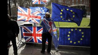 The Latest: UK