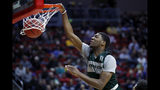Michigan State forward Aaron Henry dunks the ball during practice at the NCAA men's college basketball tournament, Wednesday, March 20, 2019, in Des Moines, Iowa. Michigan State plays Bradley on Thursday. (AP Photo/Charlie Neibergall)