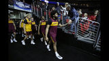 Minnesota forward Jordan Murphy leads his team to the court for practice at the NCAA men's college basketball tournament, Wednesday, March 20, 2019, in Des Moines, Iowa. Minnesota plays Louisville on Thursday. (AP Photo/Charlie Neibergall)