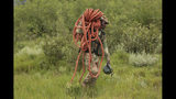 A soldier carries a rope during a rescue operation in Chimanimani about 600 kilometres south east of Harare, Zimbabwe, Tuesday, March 19, 2019. According to the government Cyclone Idai has killed more than 100 people in Chipinge and Chimanimani and according to residents the figures could be higher because the hardest hit areas are still inaccessible. Some hundreds are dead, and many more still missing with many thousands at risk from massive flooding in the region of Mozambique, Malawi and Zimbabwe caused by Cyclone Idai. (AP Photo/Tsvangirayi Mukwazhi)