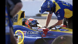 FILE - In this Sunday, March 10, 2019, file photo, Andretti Autosport driver Alexander Rossi, of United States, talks with a crew member before the warm up period at the IndyCar Grand Prix auto race in St Petersburg, Fla. Since joining IndyCar, Rossi is a five-time race winner, including the 2016 Indianapolis 500, and finished second in the championship last season. (AP Photo/Jason Behnken, File)