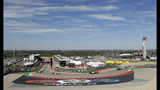 FILE - In this Oct. 21, 2018, file photo, drivers round a turn the opening lap out of turn one during the Formula One U.S. Grand Prix auto race at the Circuit of the Americas in Austin, Texas. After years of hosting the top European racing series, the Circuit of the Americas is finally racing IndyCar. The US-based series runs the first IndyCar Classic in Austin, Texas this week with a special bonus of $100,000 if the driver who qualifies in pole position also wins the race. (AP Photo/Eric Gay, File)