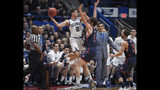 Villanova's Collin Gillespie (2) passes before falling out of bounds while St. Mary's Jordan Hunter (1) defends during the first half of a first round men's college basketball game in the NCAA tournament, Thursday, March 21, 2019, in Hartford, Conn. (AP Photo/Jessica Hill)
